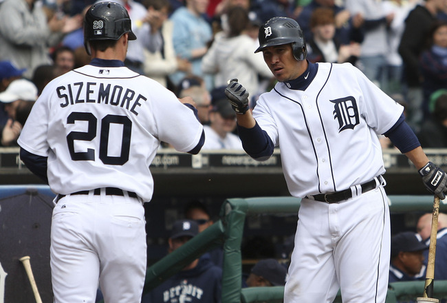 DETROIT - APRIL 13:  Magglio Ordonez #30 of the Detroit Tigers congratulates Scott Sizemore #20 after scoring on a double to left-center off the bat of Austin Jackson #14 in the seventh inning of their game against the Kansas City Royals on April 13, 2010