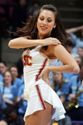 EAST RUTHERFORD, NJ - MARCH 23:  A cheerleader for the University of Southern California Trojans performs during a break in play against the University of North Carolina Tar Heels during the NCAA Men's East Regional Semifinal at Continental Airlines Arena