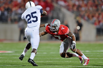 COLUMBUS, OH - NOVEMBER 13:  Jermale Hines #7 of the Ohio State Buckeyes tackles Silas Redd #25 of the Penn State Nittany Lions at Ohio Stadium on November 13, 2010 in Columbus, Ohio.  (Photo by Jamie Sabau/Getty Images)