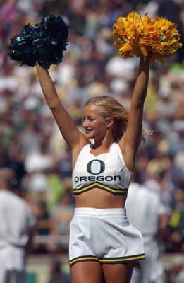 EUGENE, OR - AUGUST 31:  An Oregon Ducks cheerleader raises her pom poms during the NCAA football game against the Mississippi State Bulldogs on August 31, 2002 at Autzen Stadium in Eugene, Oregon. The Ducks defeated the Bulldogs 36-13. (Photo by: Otto Gr