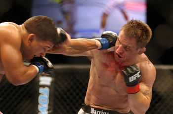 CHICAGO- OCTOBER 25:  Tyson Griffin (L) punches Sean Sherk in a Lightweight bout at UFC's Ultimate Fight Night at Allstate Arena on October 25, 2008 in Chicago, Illinois. (Photo by Tasos Katopodis/Getty Images)