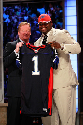 NEW YORK, NY - APRIL 28:  NFL Commissioner Roger Goodell poses for a photo with Marcell Dareus, #3 overall pick by the Buffalo Bills, as Dareus holds up a jersey during the 2011 NFL Draft at Radio City Music Hall on April 28, 2011 in New York City.  (Phot