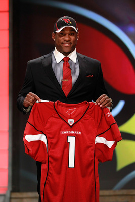NEW YORK, NY - APRIL 28:  Patrick Peterson, #5 overall pick by the Arizona Cardinals, holds up his jersey on stage during the 2011 NFL Draft at Radio City Music Hall on April 28, 2011 in New York City.  (Photo by Chris Trotman/Getty Images)