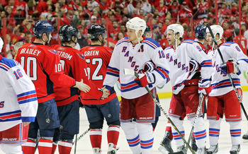 WASHINGTON , DC - APRIL 23:  Nicklas Backstrom #19 of the Washington Capitals greets Marc Staal #18 of the New York Rangers during the handshake following a 3-1 win over the Rangers in Game Five of the Eastern Conference Quarterfinals during the 2011 NHL