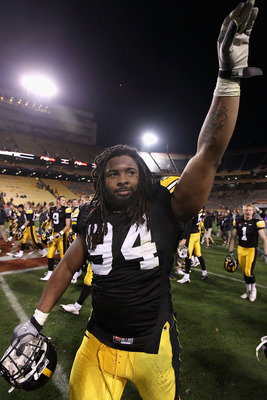 TEMPE, AZ - DECEMBER 28:  Defensive end Adrian Clayborn #94 of the Iowa Hawkeyes waves to fans as he walks off the field after defeating the Missouri Tigers in the Insight Bowl at Sun Devil Stadium on December 28, 2010 in Tempe, Arizona. The Hawkeyes defe
