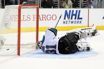 LOS ANGELES, CA - APRIL 21:  Antti Niemi #31 of the San Jose Sharks lays on the ice after allowing a goal by the Los Angeles Kings in the second period of game four of the Western Conference Quarterfinals during the 2011 NHL Stanley Cup Playoffs at Staple