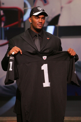 NEW YORK - APRIL 28:  Quarterback JaMarcus Russell of Louisiana State University poses for a photo with the Oakland Raiders jersey after being drafted first overall by the Raiders during the 2007 NFL Draft on April 28, 2007 at Radio City Music Hall in New