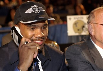 18 Apr 1998:  Fourth overall pick Charles Woodson talks on the phone after being selected by the Oakland Raiders in the first round of the 1998 NFL Draft at Madison Square Garden in Manhattan, New York. Mandatory Credit: Ezra C. Shaw  /Allsport