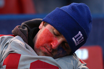 EAST RUTHERFORD, NJ - JANUARY 11:  A fan of the New York Giants sleeps during a game against the Philadelphia Eagles during the NFC Divisional Playoff Game on January 11, 2009 at Giants Stadium in East Rutherford, New Jersey.The Eagles won the game by a s