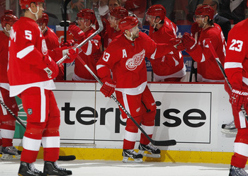 DETROIT, MI - APRIL 16: Pavel Datsyuk #13 of the Detroit Red Wings is congratulated by teammates while playing the Phoenix Coyotes in Game Two of the Western Conference Quarterfinals during the 2011 Stanley Cup Playoffs at Joe Louis Arena on April 16, 201