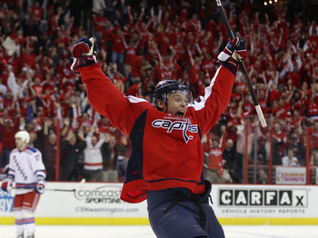 WASHINGTON, DC - APRIL 13:  Alexander Semin #28 of the Washington Capitals scores the game winning goal at 18:24 of overtime against the New York Rangers in Game One of the Eastern Conference Quarterfinals during the 2011 NHL Stanley Cup Playoffs at Veriz