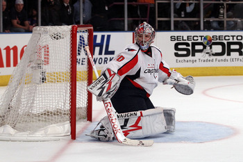 NEW YORK, NY - APRIL 20:  Goalie Michal Neuvirth #30 of the Washington Capitals looks back to the corner for the puck against the New York Rangers in Game Four of the Eastern Conference Quarterfinals during the 2011 NHL Stanley Cup Playoffs at Madison Squ