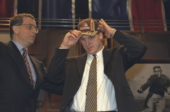 17 Apr 1999: Paul Tagliabue helps Tim Couch the number one draft pick with his hat during the NFL Draft at the Madison Square Garden in New York, New York.