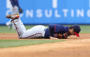 NEW YORK, NY - APRIL 07: Tsuyoshi Nishioka #1 of the Minnesota Twins lays injured after being hit by Nick Swisher #33 of the New York Yankees at Yankee Stadium on April 7, 2011 in the Bronx borough of New York City.  (Photo by Nick Laham/Getty Images)
