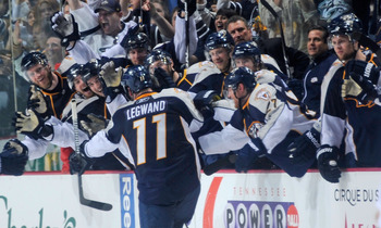 NASHVILLE, TN - APRIL 24:  David Legwand #11 of the Nashville Predators is congratulated by teammates after scoring an open net goal against the Anaheim Ducks  in Game Six of the Western Conference Quarterfinals during the 2011 NHL Stanley Cup Playoffs at