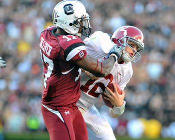 COLUMBIA, SC - OCTOBER 9: Defensive back Chris Culliver #17 of the Carolina Gamecocks tackles quarterback Greg McElroy of the Alabama Crimson Tide October 9, 2010 at Williams-Brice Stadium in Columbia, South Carolina.  (Photo by Al Messerschmidt/Getty Ima
