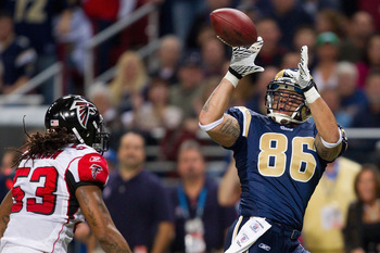 ST. LOUIS - NOVEMBER 21: Michael Hoomanawanui #86 of the St. Louis Rams hauls in a touchdown pass against the Atlanta Falcons at the Edward Jones Dome on November 21, 2010 in St. Louis, Missouri.  The Falcons beat the Rams 34-17.  (Photo by Dilip Vishwana