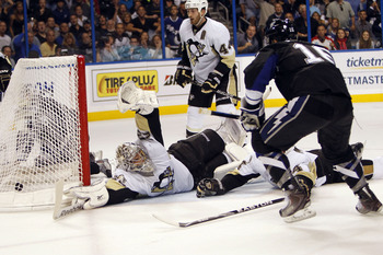TAMPA, FL - APRIL 25: Teddy Purcell #16 of the Tampa Bay Lightning shoots and scores against Goaltender Mark-Andre Fleury #29 of the Pittsburgh Penguins in Game Six of the Eastern Conference Quarterfinals during the 2011 NHL Stanley Cup Playoffs at the St