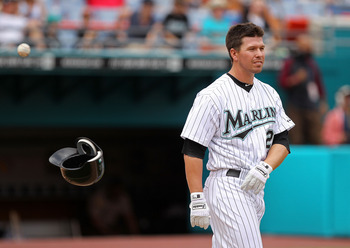 MIAMI GARDENS, FL - APRIL 24: Donnie Murphy #22 of the Florida Marlins walks to the field after striking out during a game against the Colorado Rockies at Sun Life Stadium on April 24, 2011 in Miami Gardens, Florida.  (Photo by Mike Ehrmann/Getty Images)