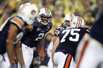 GLENDALE, AZ - JANUARY 10:  Cameron Newton #2 of the Auburn Tigersc reacts with his team against the Oregon Ducks during the Tostitos BCS National Championship Game at University of Phoenix Stadium on January 10, 2011 in Glendale, Arizona.  (Photo by Chri