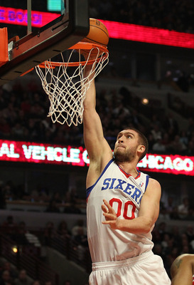 CHICAGO, IL - MARCH 28: Spencer Hawes #00 of the Philadelphia 76ers dunks the ball against the Chicago Bulls at the United Center on March 28, 2011 in Chicago, Illinois. NOTE TO USER: User expressly acknowledges and agrees that, by downloading and/or usin