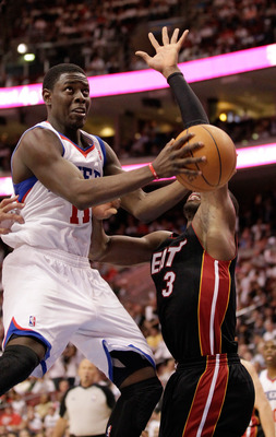 PHILADELPHIA, PA - APRIL 21: Jrue Holiday #11 of the Philadelphia 76ers drives to the basket while being guarded by Dwyane Wade #3 of the Miami Heat in Game Three of the Eastern Conference Quarterfinals during the 2011 NBA Playoffs at Wells Fargo Center o