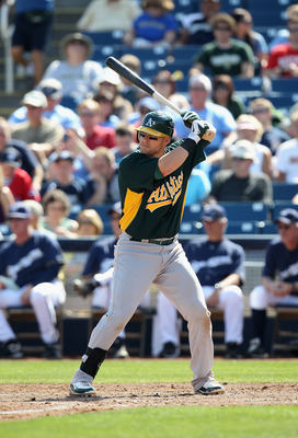 PHOENIX, AZ - MARCH 03:  Daric Barton #10 of the Oakland Athletics bats against the Milwaukee Brewers during the spring training game at Maryvale Baseball Park on March 3, 2011 in Phoenix, Arizona.  (Photo by Christian Petersen/Getty Images)