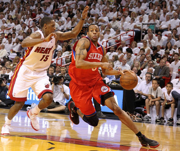 MIAMI, FL - APRIL 27:  Andre Iguodala #9 of the Philadelphia 76ers drives to the rim past Mario Chalmers #15 of the Miami Heat  during game five of the Eastern Conference Quarterfinals in the 2011 NBA Playoffs at American Airlines Arena on April 27, 2011