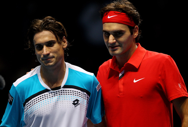 LONDON, ENGLAND - NOVEMBER 21:  Roger Federer of Switzerland (R) and  David Ferrer of Spain pose for press on court after their men's singles first round match during the Barclays ATP World Tour Finals at O2 Arena on November 21, 2010 in London, England.