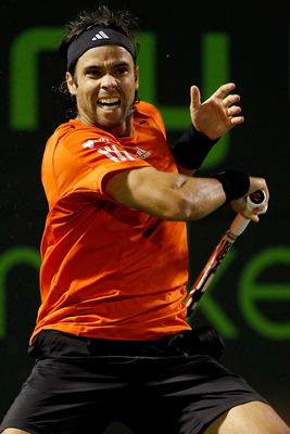 KEY BISCAYNE, FL - MARCH 29:  Fernando Gonzalez of Chile returns a shot to Juan Monaco of Argentina during day seven of the 2010 Sony Ericsson Open at Crandon Park Tennis Center on March 29, 2010 in Key Biscayne, Florida.  (Photo by Matthew Stockman/Getty