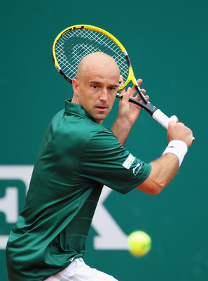MONACO - APRIL 14:  Ivan Ljubicic of Croatia plays a backhand in his match against Tomas Berdych of Czech Republic in action against  during Day Five of the ATP Masters Series Tennis at the Monte Carlo Country Club on April 14, 2011 in Monte Carlo, Monaco