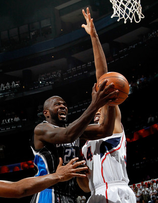 ATLANTA, GA - APRIL 28:  Jason Richardson #23 of the Orlando Magic drives against Jason Collins #34 of the Atlanta Hawks during Game Six of the Eastern Conference Quarterfinals in the 2011 NBA Playoffs at Philips Arena on April 28, 2011 in Atlanta, Georgi