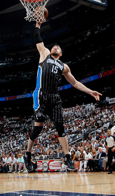 ATLANTA, GA - APRIL 24:  Hedo Turkoglu #15 of the Orlando Magic dunks past Josh Smith #5 of the Atlanta Hawks during Game Four of the Eastern Conference Quarterfinals in the 2011 NBA Playoffs at Philips Arena on April 24, 2011 in Atlanta, Georgia.  NOTE T