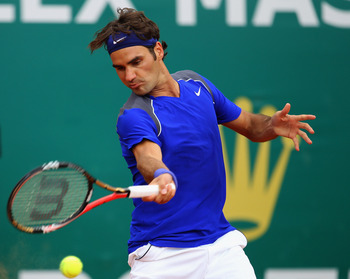 MONACO - APRIL 15:  Roger Federer of Switzerland plays a forehand in his match against Jurgen Melzer of Austria during Day Six of the ATP Masters Series Tennis at the Monte Carlo Country Club on April 15, 2011 in Monte Carlo, Monaco.  (Photo by Julian Fin
