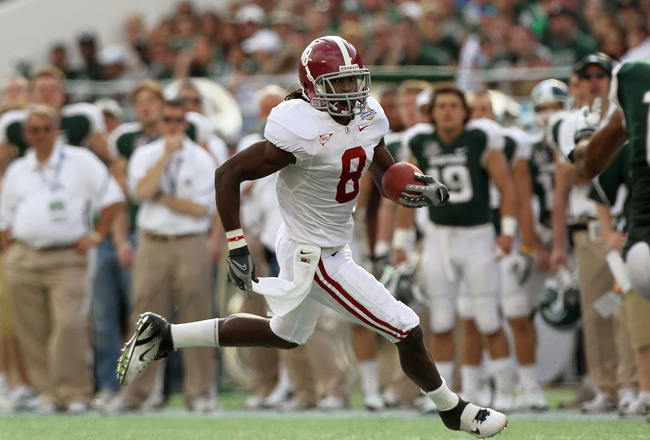 ORLANDO, FL - JANUARY 01: Julio Jones #8 of the Alabama Crimson Tide rushes for a touchdown during the Capitol One Bowl against the Michigan State Spartans at the Florida Citrus Bowl on January 1, 2011 in Orlando, Florida.  (Photo by Mike Ehrmann/Getty Im