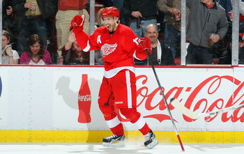 DETROIT,MI- APRIL 13:  Pavel Datsyuk #13 of the Detroit Red Wings celebrates his 2nd period goal against the Phoenix Coyotes in Game One of the Western Conference Quarterfinals during the 2011 NHL Stanley Cup Playoffs at at Joe Louis Arena on April 13, 20
