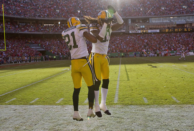 KANSAS CITY, MO - NOVEMBER 4: Charles Woodson #21 and Al Harris #31 both of the Green Bay Packers celebrate Woodson's touchdown return of an interception against the Kansas City Chiefs at Arrowhead Stadium November 4, 2007 in Kansas City, Missouri.  The P