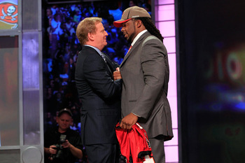 NEW YORK, NY - APRIL 28:  NFL Commissioner Roger Goodell (L) greets Adrian Clayborn, #20 overall pick by the Tampa Bay Buccaneers, on stage during the 2011 NFL Draft at Radio City Music Hall on April 28, 2011 in New York City.  (Photo by Chris Trotman/Get