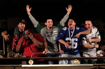 NEW YORK, NY - APRIL 28:  Fans of the New York Giants and the New England Patrios cheer in the balcony during the 2011 NFL Draft at Radio City Music Hall on April 28, 2011 in New York City.  (Photo by Chris Trotman/Getty Images)