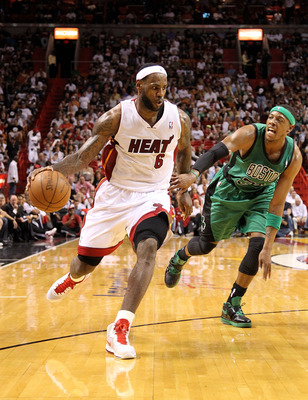 MIAMI, FL - APRIL 10:  LeBron James #6 of the Miami Heat posts up Paul Pierce #34 of the Boston Celtics during a game  at American Airlines Arena on April 10, 2011 in Miami, Florida. NOTE TO USER: User expressly acknowledges and agrees that, by downloadin