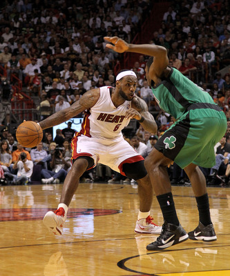 MIAMI, FL - APRIL 10:  LeBron James #6 of the Miami Heat drives on Jeff Green #8 of the Boston Celtics during a game  at American Airlines Arena on April 10, 2011 in Miami, Florida. NOTE TO USER: User expressly acknowledges and agrees that, by downloading
