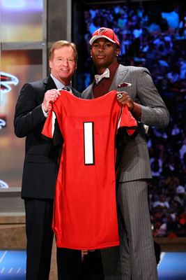 NEW YORK, NY - APRIL 28:  NFL Commissioner Roger Goodell (L) poses for a photo with Julio Jones, #6 overall pick by the Atlanta Falcons, holds up a jersey on stage during the 2011 NFL Draft at Radio City Music Hall on April 28, 2011 in New York City.  (Ph