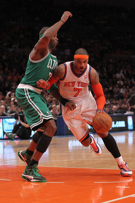 NEW YORK, NY - APRIL 22:  Carmelo Anthony #7 of the New York Knicks drives against Jermaine O'Neal #7 of the Boston Celtics in Game Three of the Eastern Conference Quarterfinals in the 2011 NBA Playoffs on April 22, 2011 at Madison Square Garden in New Yo