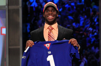 NEW YORK, NY - APRIL 28:  Prince Amukamara, #19 overall pick by the New York Giants, holds up a jersey on stage during the 2011 NFL Draft at Radio City Music Hall on April 28, 2011 in New York City.  (Photo by Chris Trotman/Getty Images)