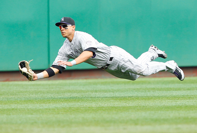 PITTSBURGH - APRIL 07:  Carlos Gonzalez #5 of the Colorado Rockies makes a diving catch during the Opening Day game against the Pittsburgh Pirates on April 7, 2011 at PNC Park in Pittsburgh, Pennsylvania.  (Photo by Jared Wickerham/Getty Images)