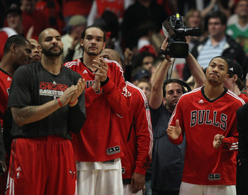 CHICAGO, IL - APRIL 26: (L-R) Carlos Boozer #5, Joakim Noah #13 and Derrick Rose #1 of the Chicago Bulls celebrate a win over the Indiana Pacers in Game Five of the Eastern Conference Quarterfinals in the 2011 NBA Playoffs at the United Center on April 26