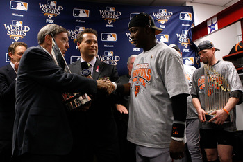 ARILINGTON, TX - NOVEMBER 1:  World Series MVP Edgar Renteria of the San Francisco Giants receives his MVP trophy from Major League Baseball Commissioner Bud Selig in the locker room after the Giants won 3-1 against the Texas Rangers in Game Five of the 2