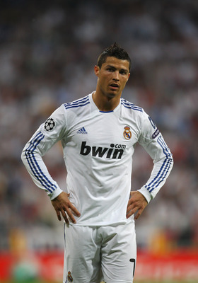 MADRID, SPAIN - APRIL 27:  Cristiano Ronaldo of Real Madrid looks dejected during the UEFA Champions League Semi Final first leg match between Real Madrid and Barcelona at Estadio Santiago Bernabeu on April 27, 2011 in Madrid, Spain.  (Photo by Alex Lives