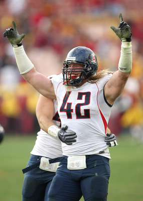 LOS ANGELES, CA - DECEMBER 05:  Defensive end Brooks Reed #42 of the Arizona Wildcats celebrates after stopping the USC Trojans on the final play on December 5, 2009 at the Los Angeles Coliseum in Los Angeles, California. Arizona won 21-17.  (Photo by Ste
