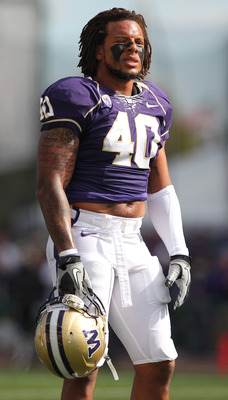 SEATTLE - SEPTEMBER 11:  Linebacker Mason Foster #40 of the Washington Huskies looks on during warmups prior to the game against the Syracuse Orange on September 11, 2010 at Husky Stadium in Seattle, Washington. (Photo by Otto Greule Jr/Getty Images)